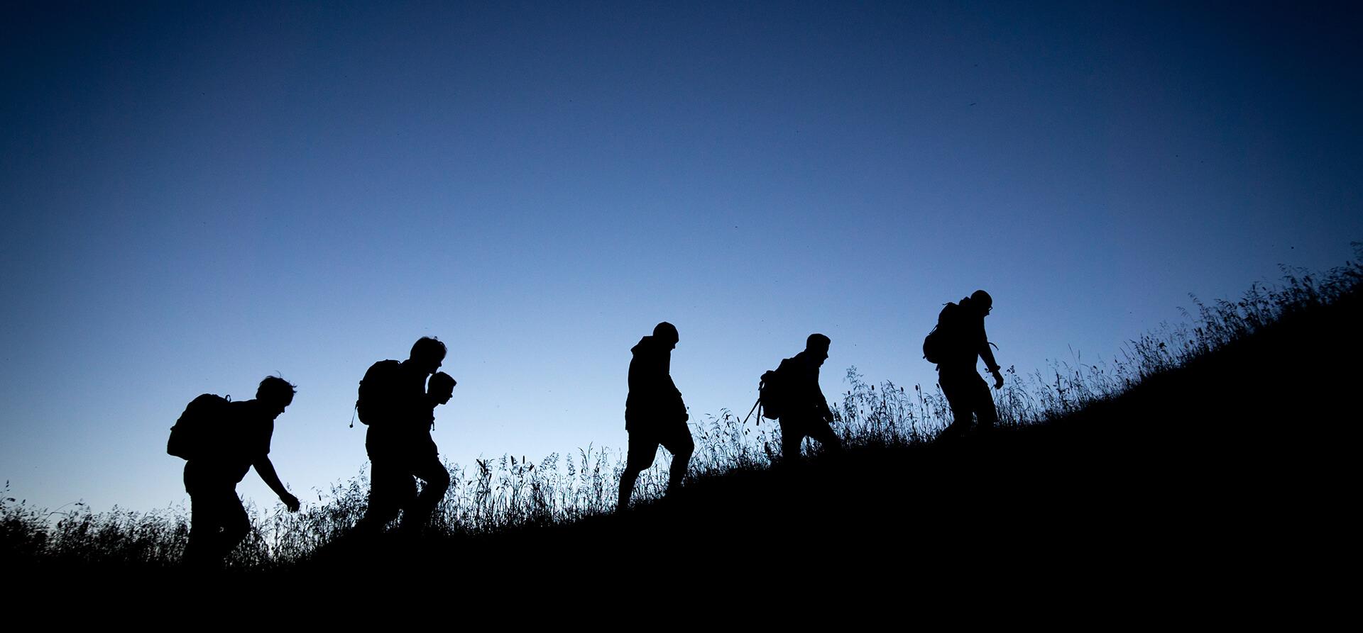 People Walking on Mountains